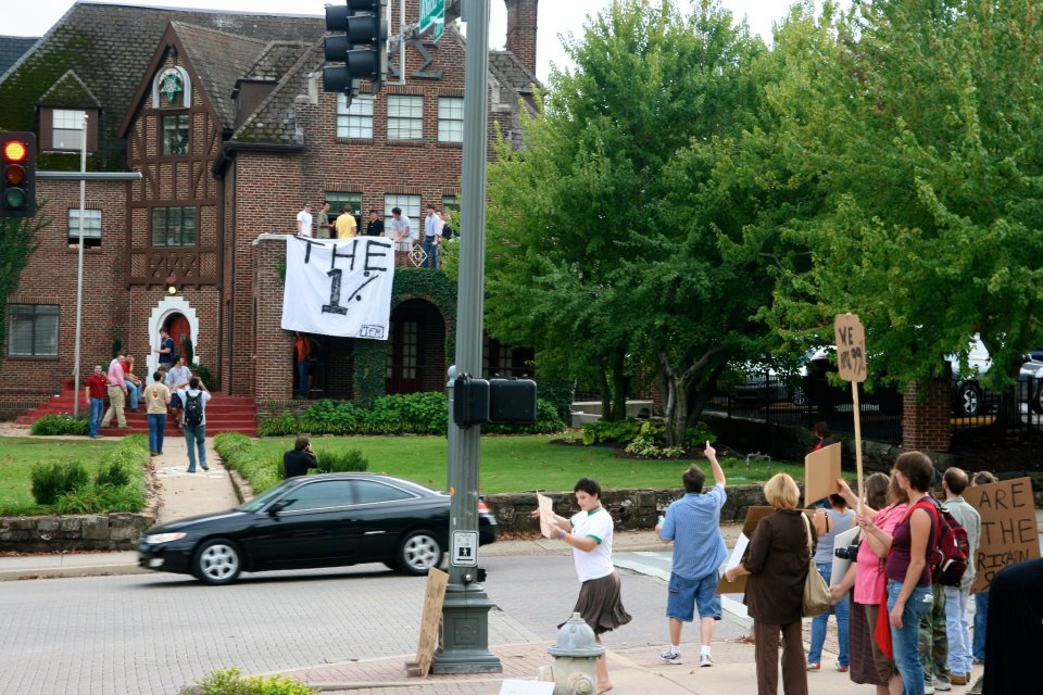 Arkansas Fraternity Drops 1% Banner in front of Protestors
