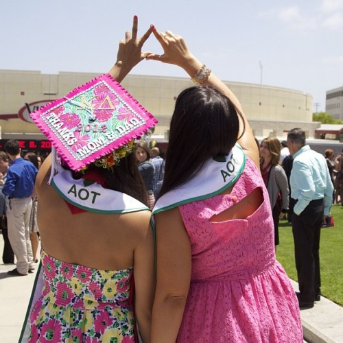 Graduating with Lilly, letters, and sisters. TSM.