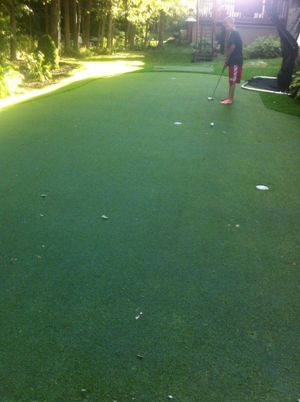 Having a putting green in your backyard. TFM.