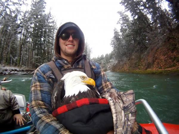 Rescuing an injured bald eagle while fishing. TFM.